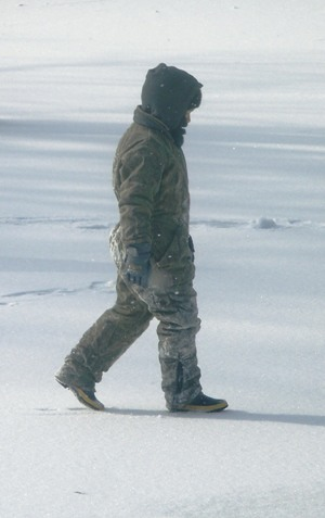 Snow Boy Walking on Ice